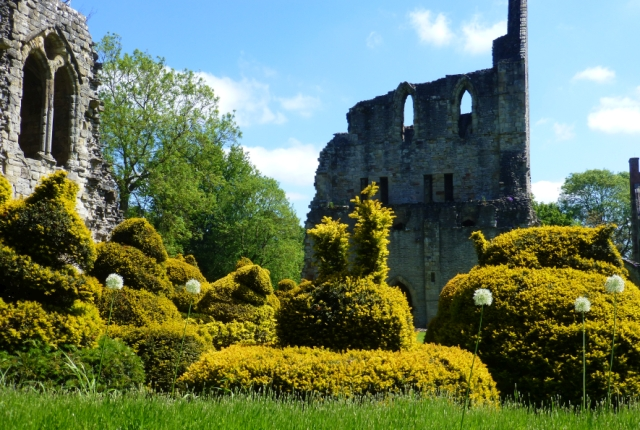 animal shaped topiary in the cloister of wenlock priory, shropshire